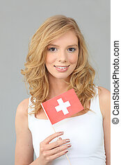 Woman with Swiss flag on gray background