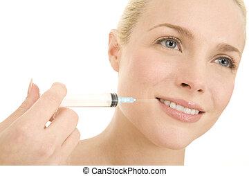 Woman with syringe of Botox
