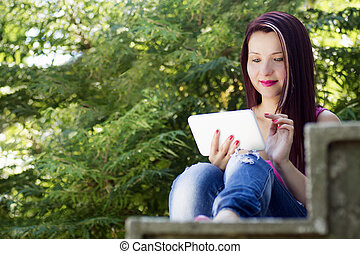 woman with tablet in nature