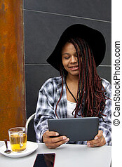 woman with tablet in the cafeteria
