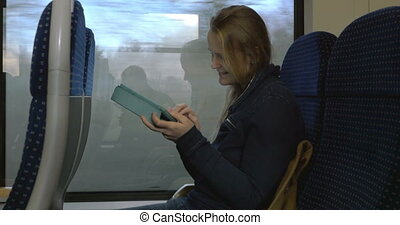 Woman with Tablet PC on Train