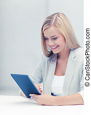 woman with tablet pc - picture of smiling woman with tablet...
