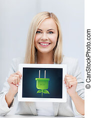 woman with tablet pc with electrical eco plug - woman with...