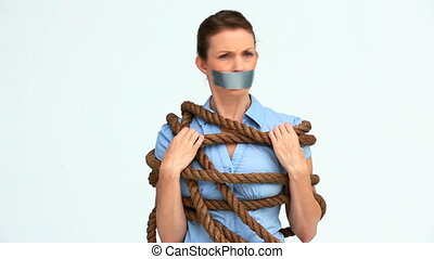 Woman with tape on the mouth and attached with a rope...
