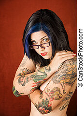 Woman with tattoos and crossed arms