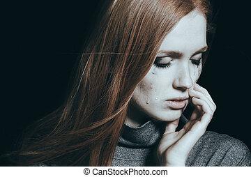 Woman with tears on cheek