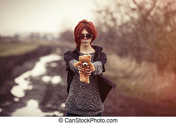 woman with teddy bear toy