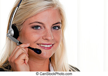Woman with telephone headset in a call center