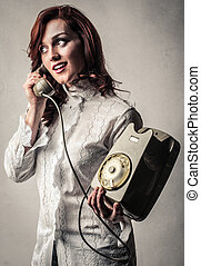 Woman with telephone - Brunette woman telephoning on vintage...