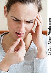 Woman with terrible headache