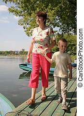 woman with the boy on the moorage