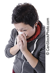 woman with the flu blowing her nose