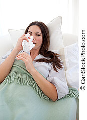 Woman with the flu lying on the sofa