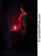 Woman with the old lantern - Beautiful woman with the old...