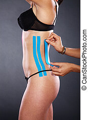 woman with therapeutic tape