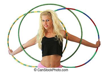 Woman with three hula hoops