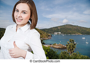 Woman with thumbs up on the beach baclground.