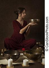 Woman with Tibetan bowls