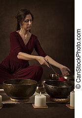 Woman with Tibetan singing bowls