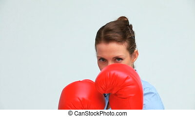 Woman with tied hair boxing against green background