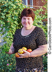 woman with tomatoes in hands
