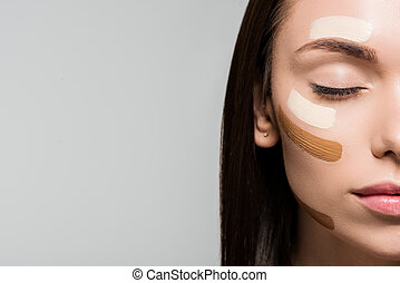 woman with tonal foundation on face - attractive young woman...