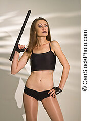 Woman with tonfa stock
