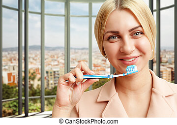 Woman with tooth brush - Portrait of smiling woman with...