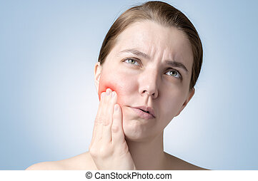 Woman with toothache - Young woman suffering from toothache