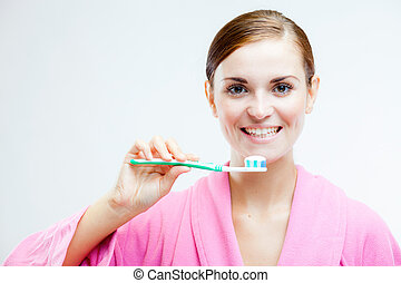 Woman with toothbrush, dental care