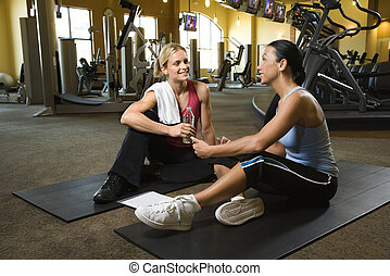 Woman with trainer at gym.