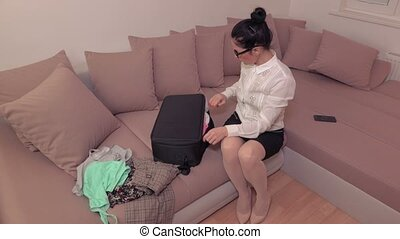 woman with travel bag at home before journey