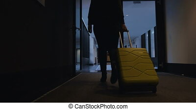Woman with travel bag walking to her hotel room