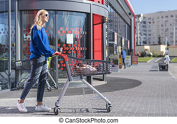 woman with trolley at a supermarket