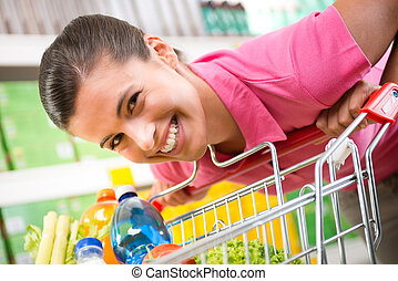 Woman with trolley at store