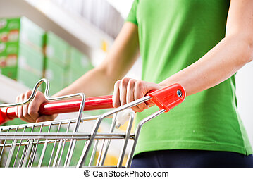 Woman with trolley at supermarket