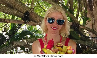 Woman with tropical fruit dish - SLOW MOTION:Healthy exotic...