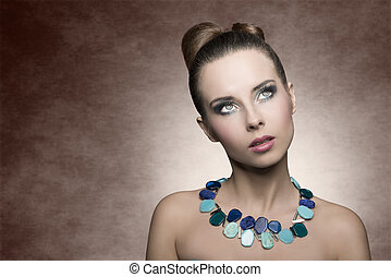 woman with turquoise make-up