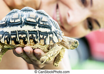 Woman with turtle