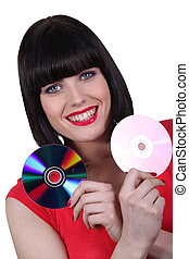 Woman with two CDs
