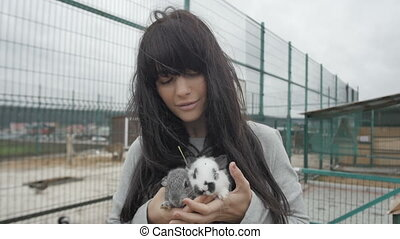 Woman with two cute rabbits