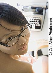 Woman with typewriter.