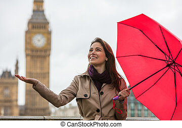 Woman With Umbrella by Big Ben, London, England