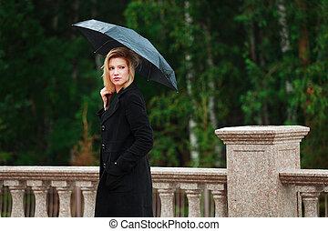 Woman with umbrella in the rain