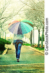 Woman with umbrella. Photo in old image style.