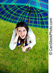 Woman with umbrella scared about storm coming