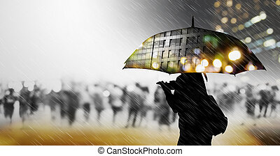 Woman with umbrella walking in the city