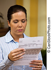 Woman with unpaid bills - A woman with unpaid bills