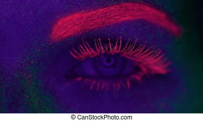 Woman with UV fluorescent makeup - Closeup woman face and...