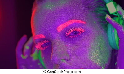 Woman with UV fluorescent makeup